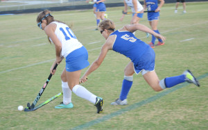 Lady Trojan Kiersten Fuller (10) plays keep away from Ally Mott during an intense first half play.Robb Johnson photo
