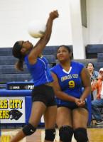 Charles City's Tadayzia Jones (left) attempts an overhead volley as teammate Kourtney Wyatt (9) slides over for assistance.Andre' Jones photo